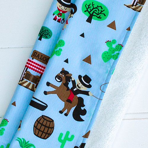 A picture of on of our, supersoft bamboo and cotton burp cloth (blue cowboys pattern)